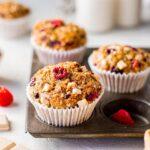 vegan banana raspberry white chocolate muffins close up in tray