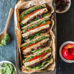 Baked tofu sandwich with caramelised onion and pesto