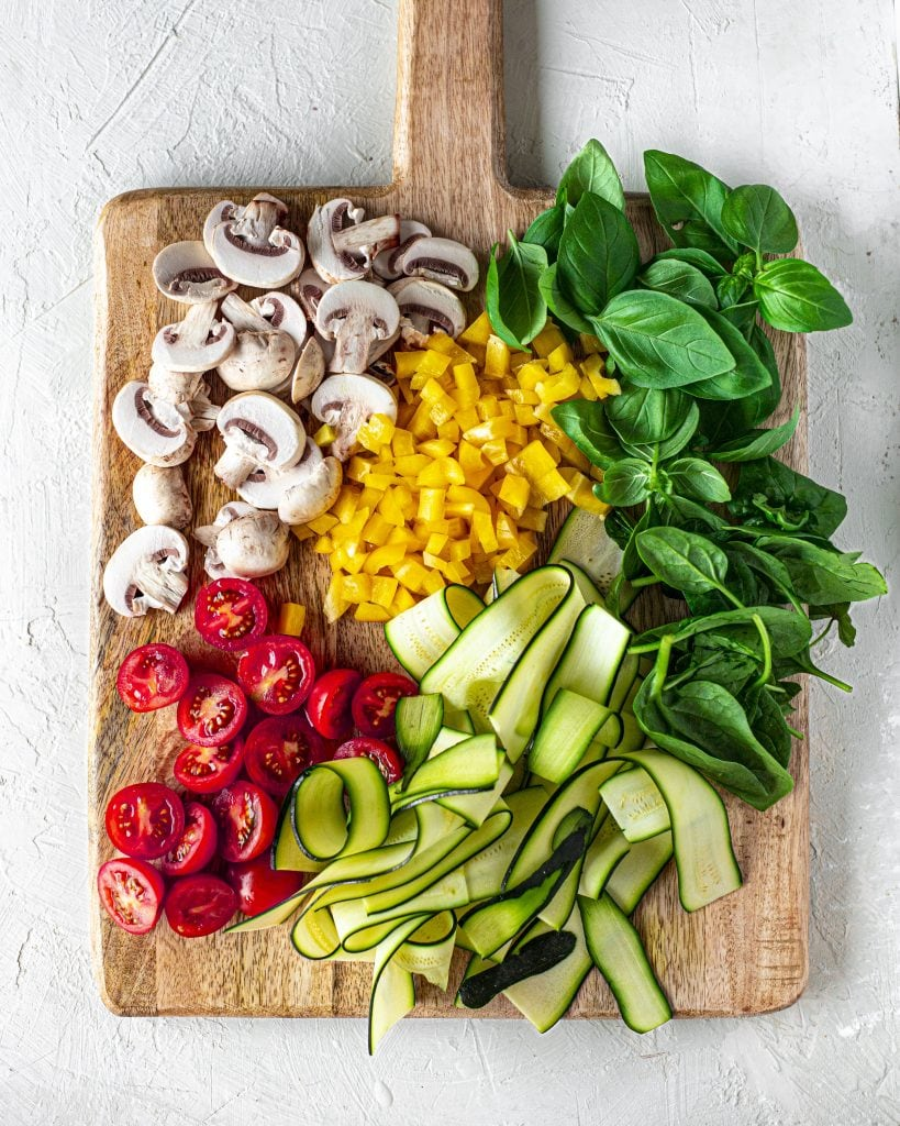 Flatlay of raw veggies to top pita bread.