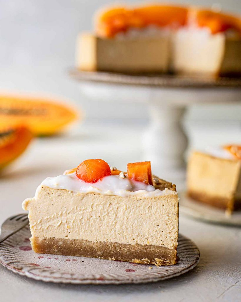 Close up of slice of vegan papaya cheesecake
