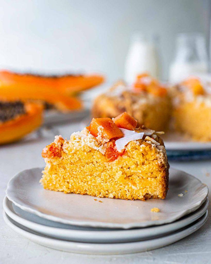 Close up of a beautiful golden slice of papaya cake