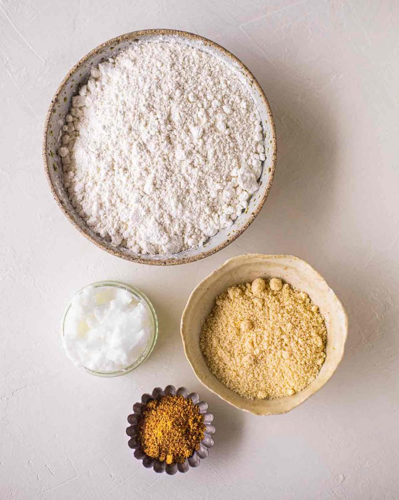 Flatlay of ingredients for the crust of the baked vegan cheescake