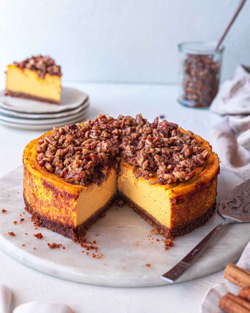 Low angle of baked vegan pumpkin cheesecake showing creamy interior