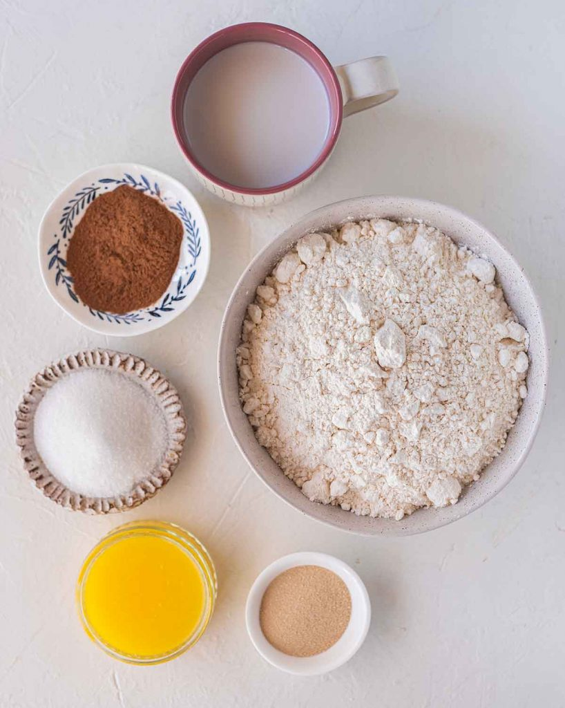 Flatlay of ingredients for the gingerbread cinnamon roll dough
