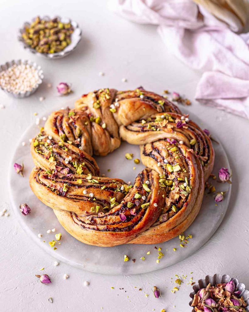 Side angle of Christmas bread wreath on marble board