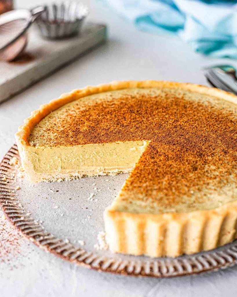 Vegan egg custard tart pie close up showing creamy texture