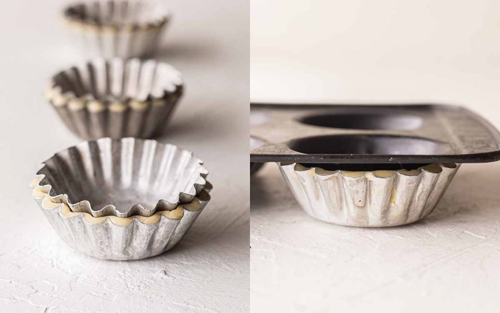 Two image collage showing blind baking hacks for the mini tart tins. One image has a tart tin, pressed pastry and another tart tin on top. The other image has a tart tin filled with pastry and a flat cupcake tray on top