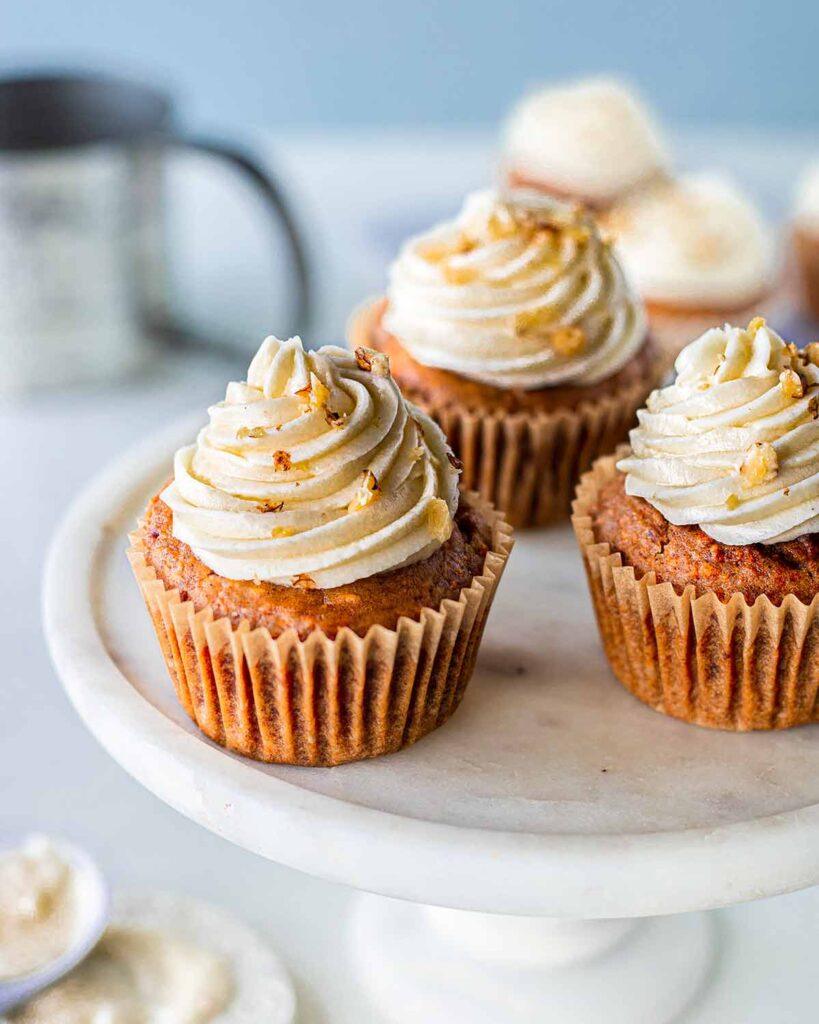 Easy vegan carrot cake cupakes with cream cheese frosting on cake stand