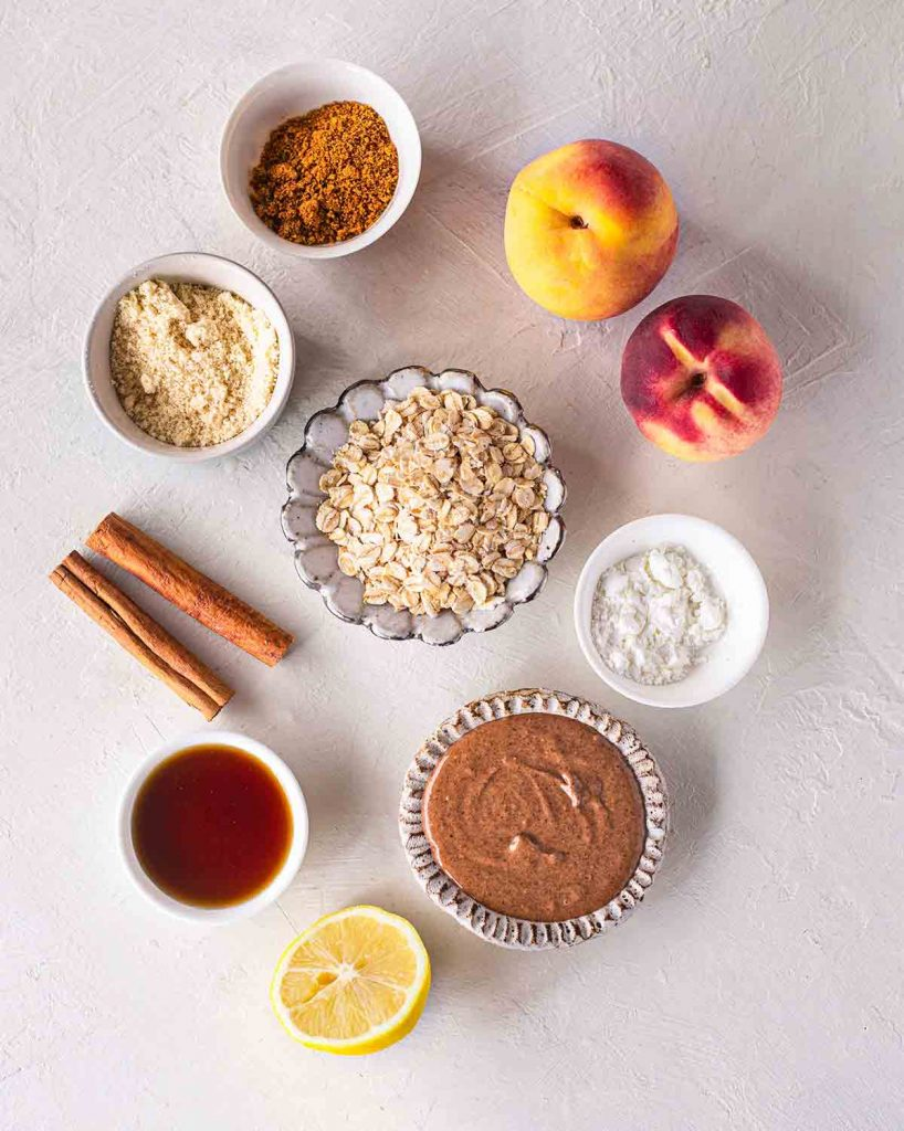 Flatlay of dairy free and gluten free ingredients for peach crumble