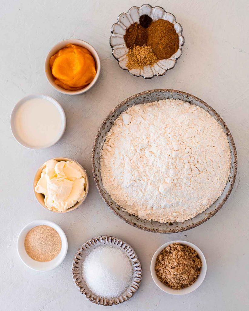 Flatlay of simple ingredients to make vegan pumpkin cinnamon rolls.