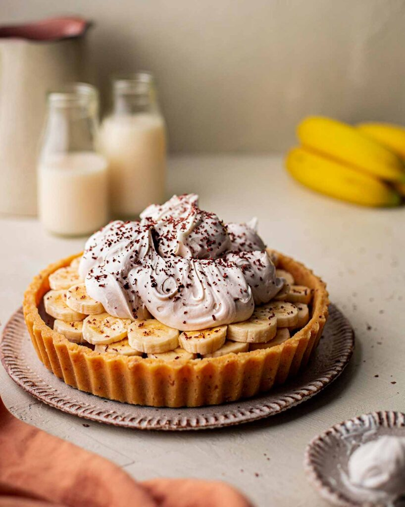 Photography of vegan banoffee pie with ingredients in foreground and background