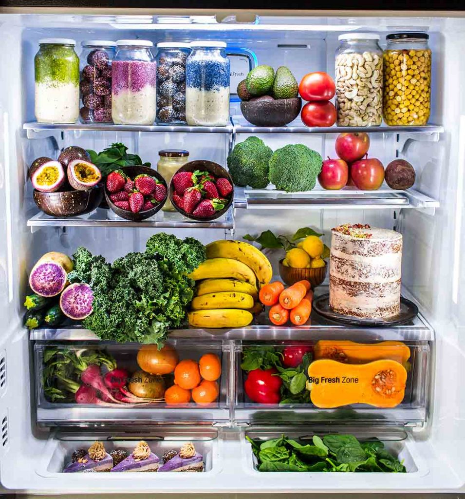 styled image of fridge packed with fresh fruit, vegetables and meal prep