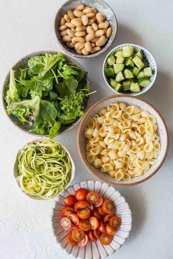 Flatlay of salad ingredients for Vegan Layered Pasta Salad