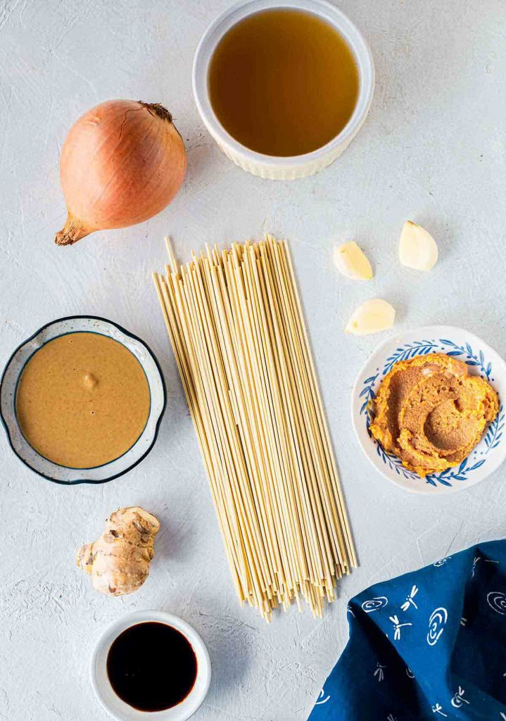 Core ingredients for easy quick vegan ramen noodle soup with miso sesame broth