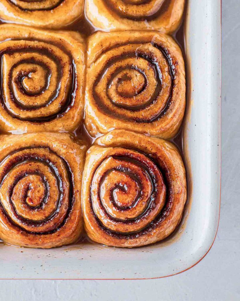 Close up of sticky buns in baking tray