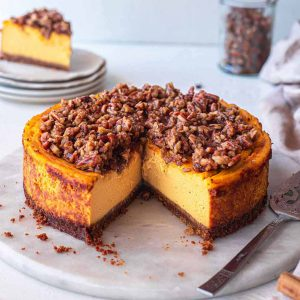baked vegan pumpkin cheesecake on marble board