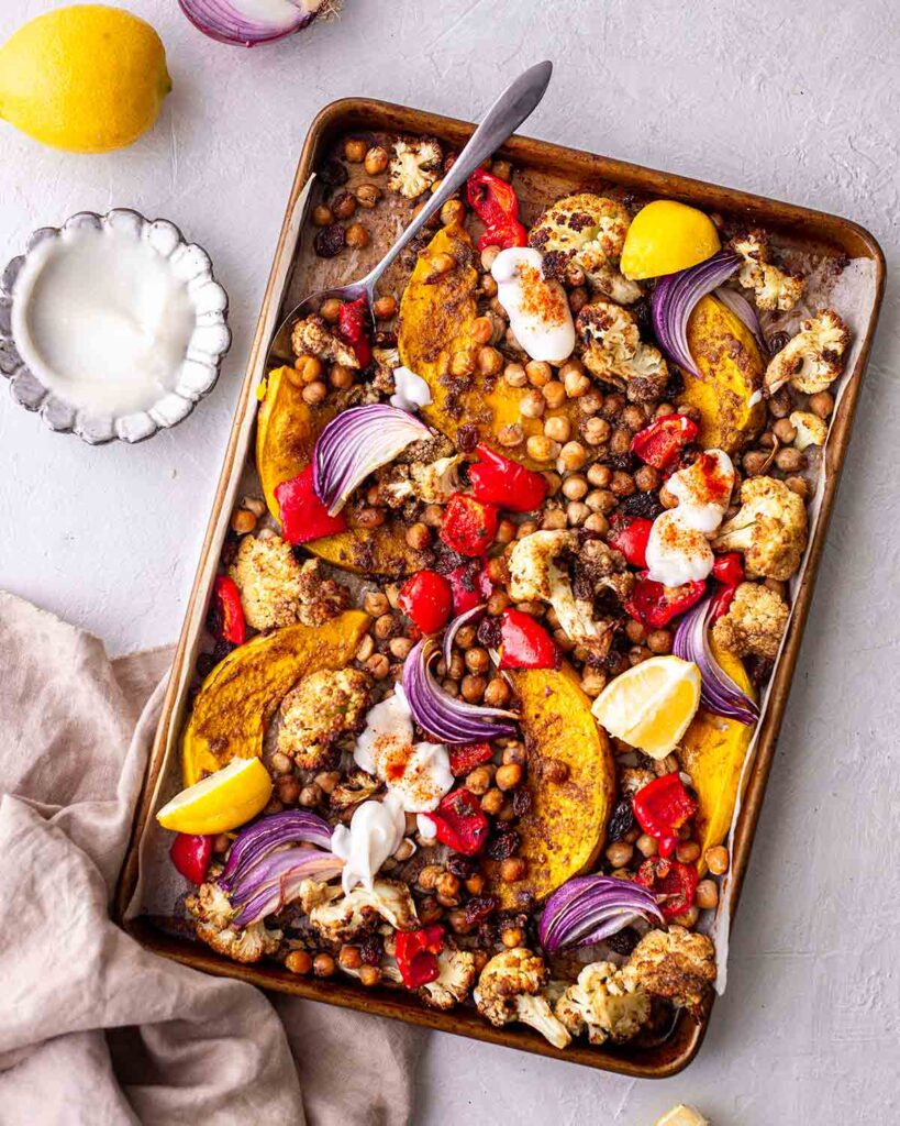 Colourful moroccan vegetable tray bake with a side of coconut yoghurt