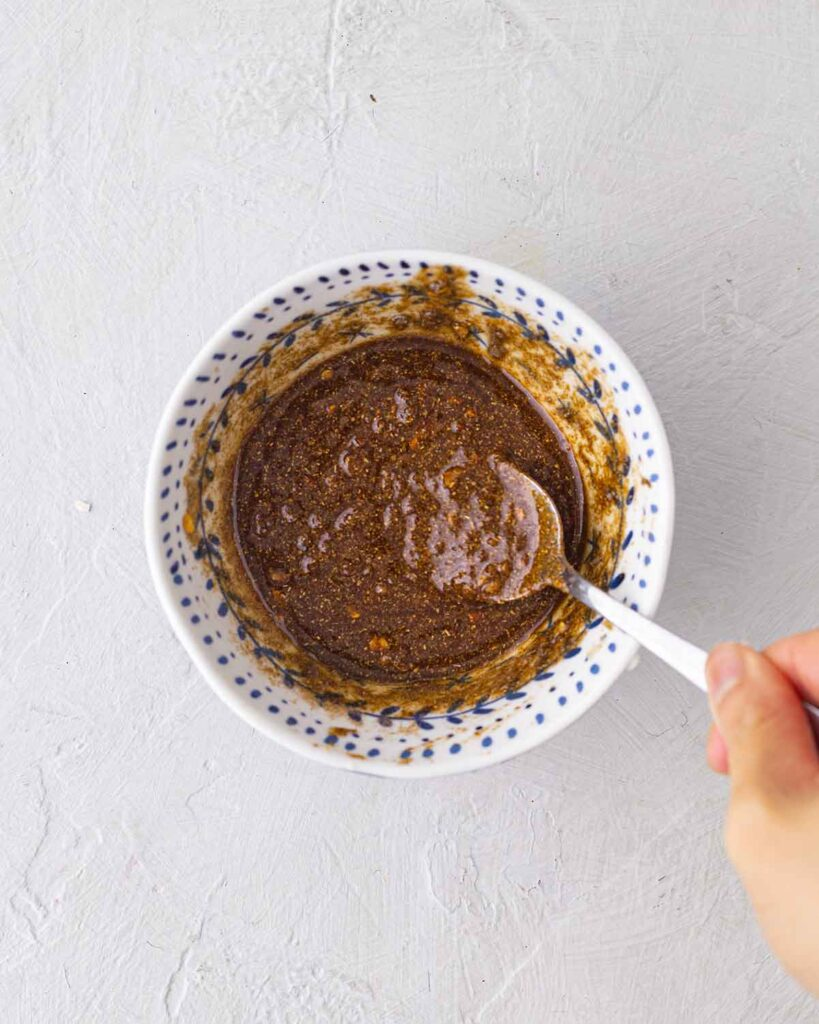 Bowl of spiced dressing made of olive oil, garlic and spices