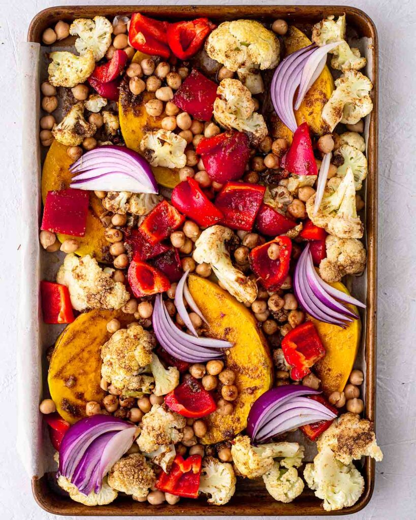 Half baked vegetable tray bake with colourful vegetables and spices