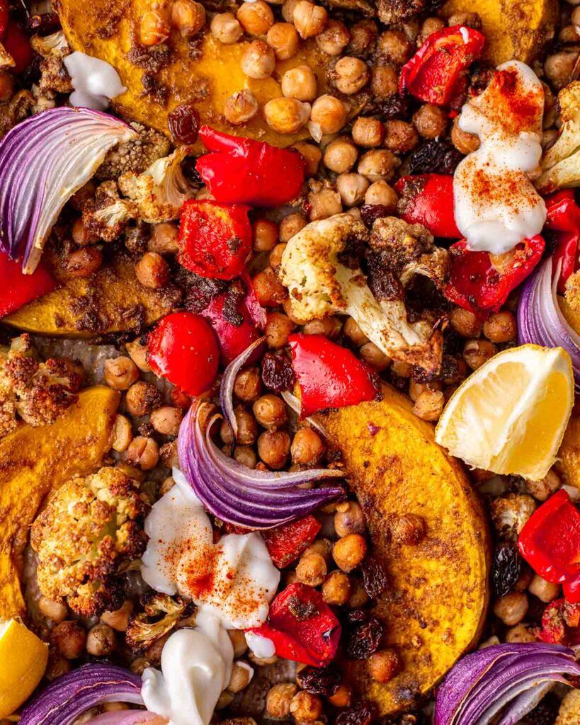 close up of roasted and spiced vegetables on baking tray