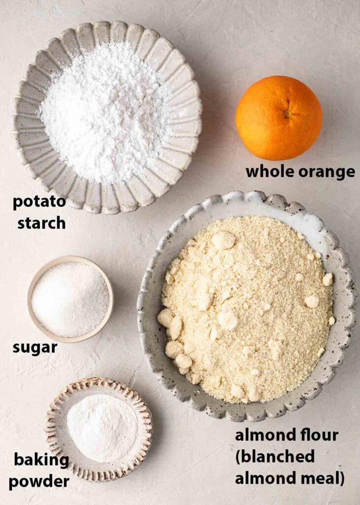 Flatlay of 5 ingredients for vegan whole orange cake