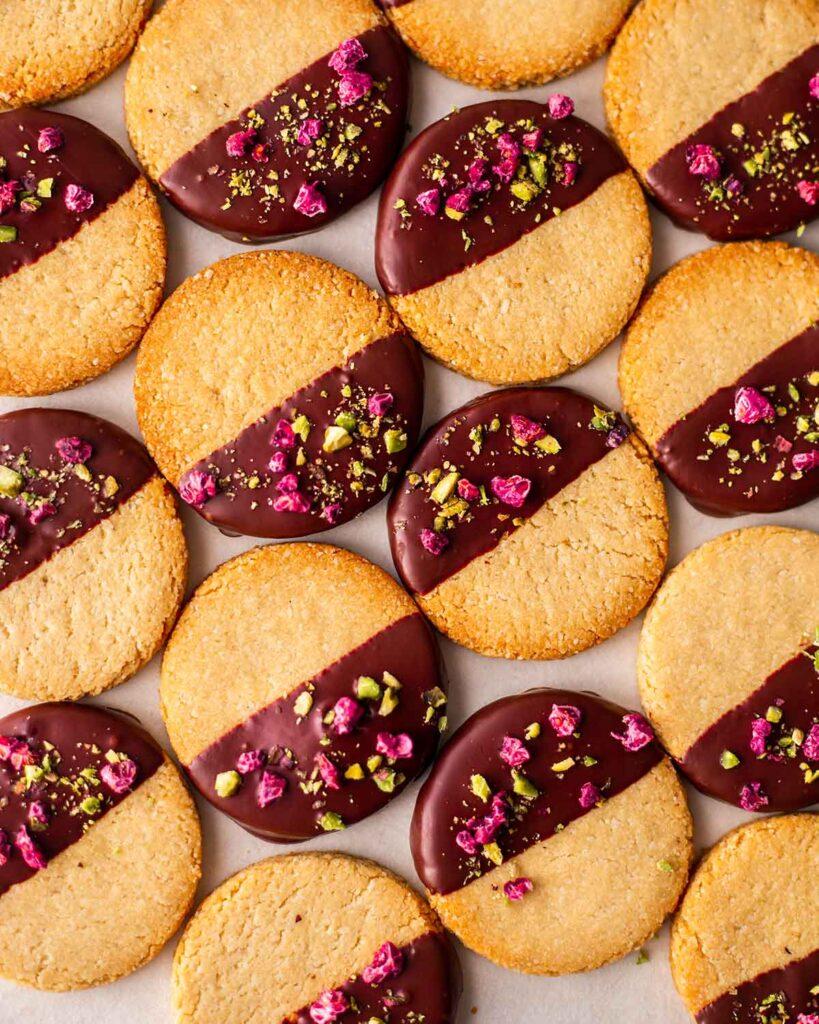 Flatlay of oil free vegan cookies half dipped in chocolate