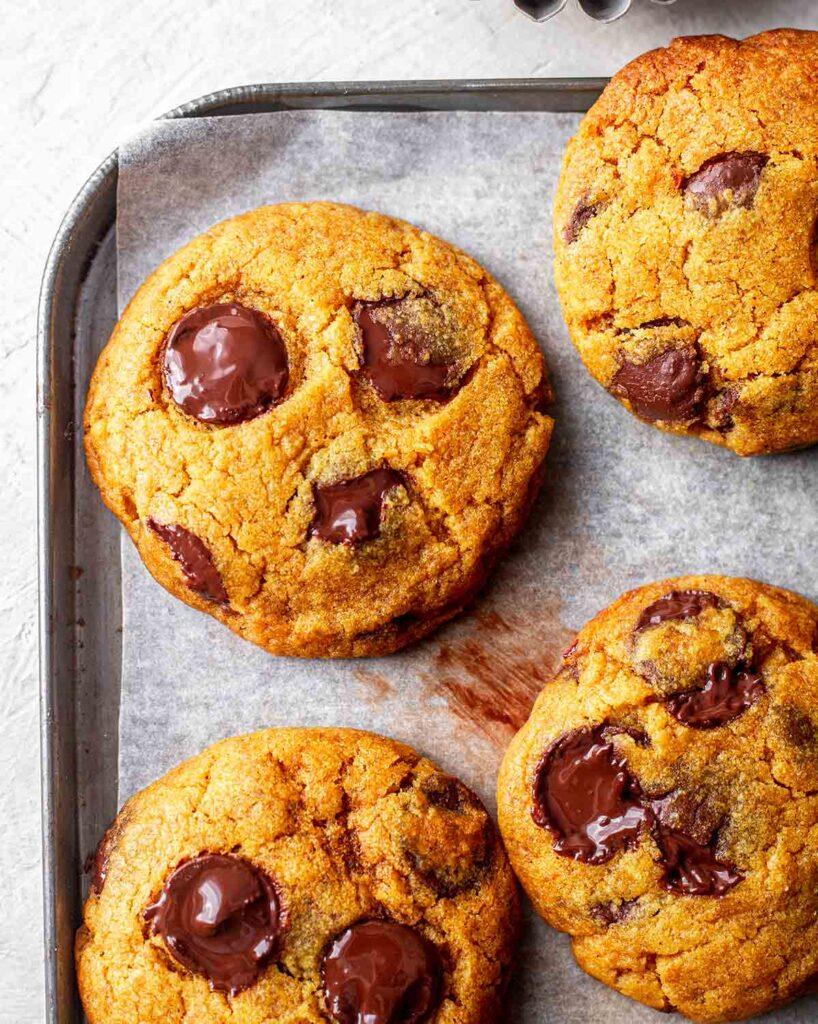 Close up of golden chewy vegan pumpkin cookie.