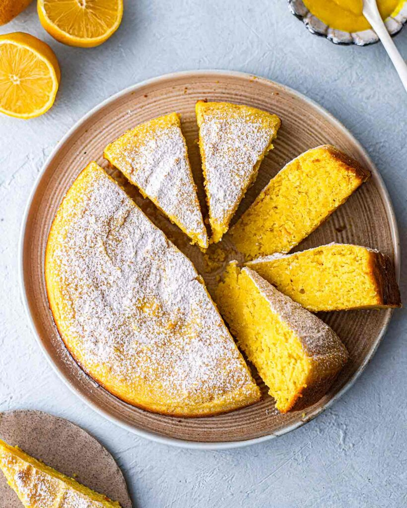 Lemon cake on plate with slices coming out.