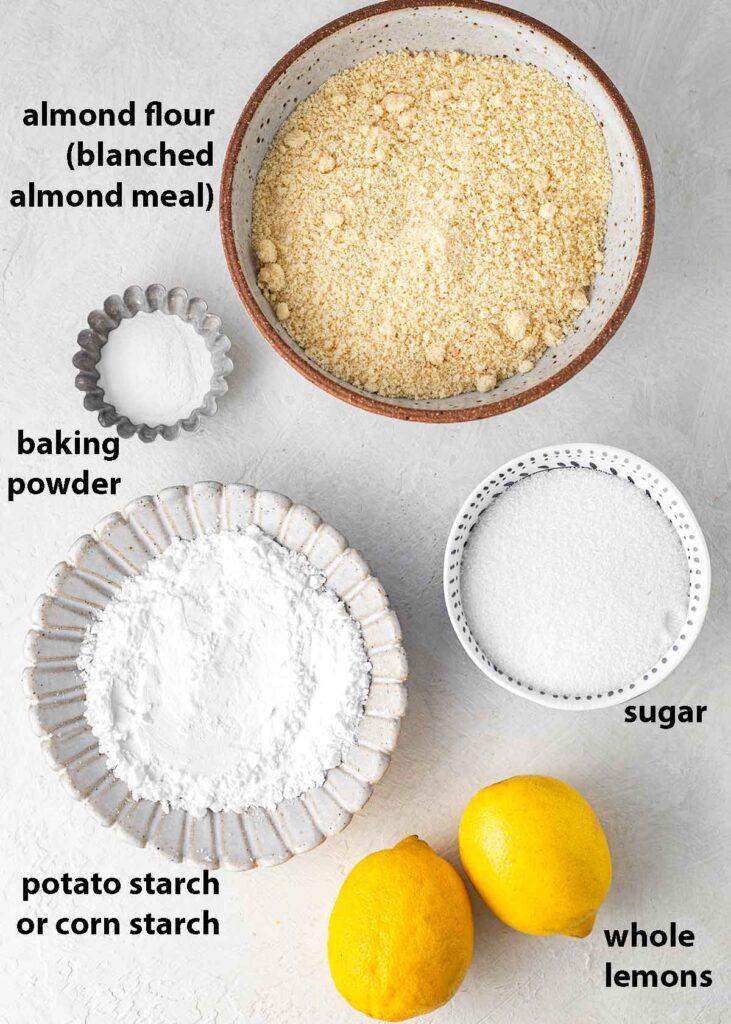 Flatlay of 5 key ingredients for whole lemon cake.