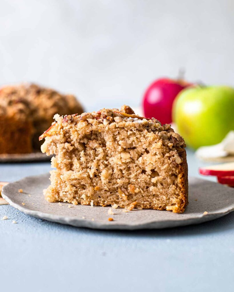 Close up of rustic, moist and fluffy texture of one slice of the apple cake..