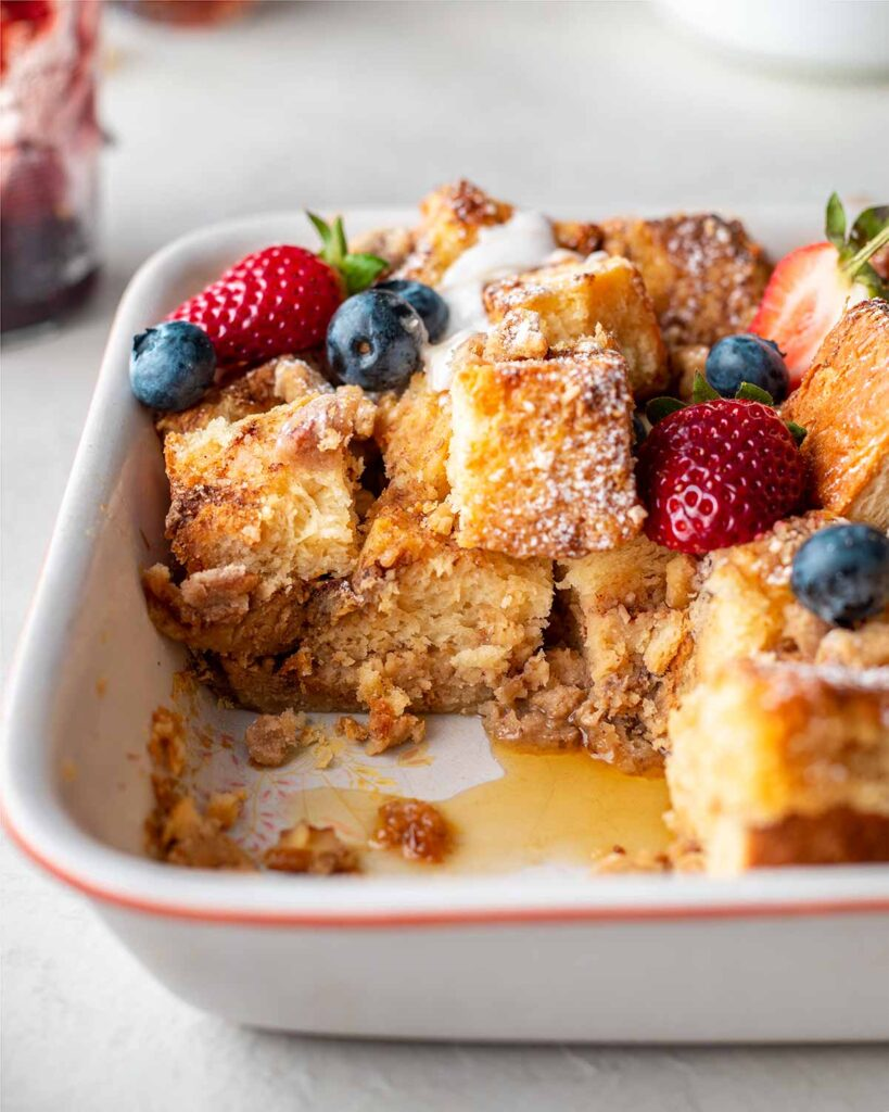 Close up of vegan french toast casserole cut into cubes.