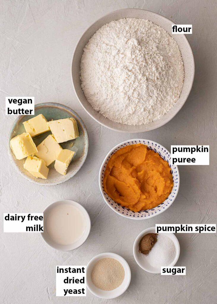 Flatlay of ingredients for the vegan pumpkin dinner rolls.