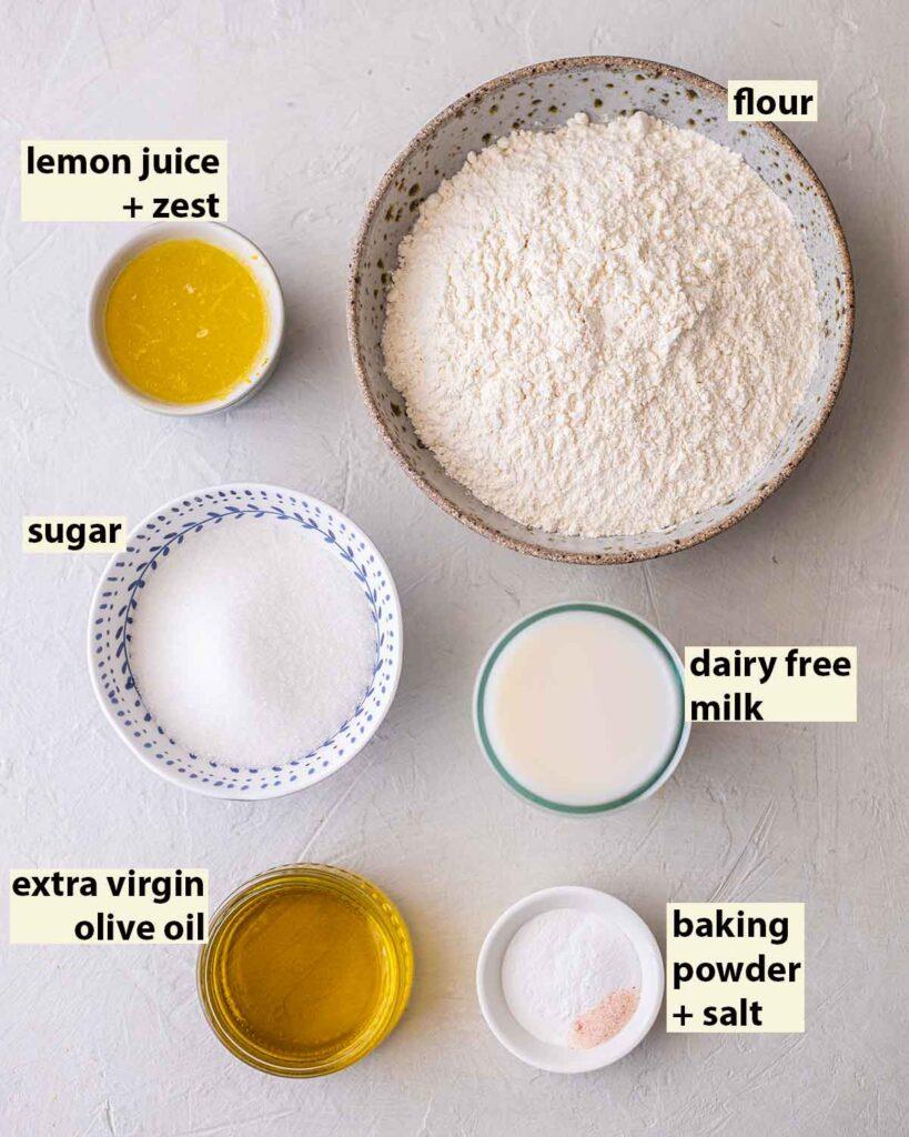 Flatlay of ingredients for vegan lemon olive oil cake.